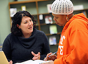 A libraian works with a student at the Salem Campus of Kent State University.
