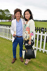 ANDY & PATTI WONG at the Cartier Queen's Cup Final polo held at Guards Polo Club, Smith's Lawn, Windsor Great Park, Egham, Surrey on 15th June 2014.