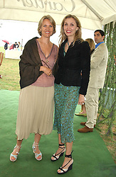 Left to right, CARLA BAMBERGER and ALLEGRA HICKS at the 2005 Cartier International Polo between England & Australia held at Guards Polo Club, Smith's Lawn, Windsor Great Park, Berkshire on 24th July 2005.<br />