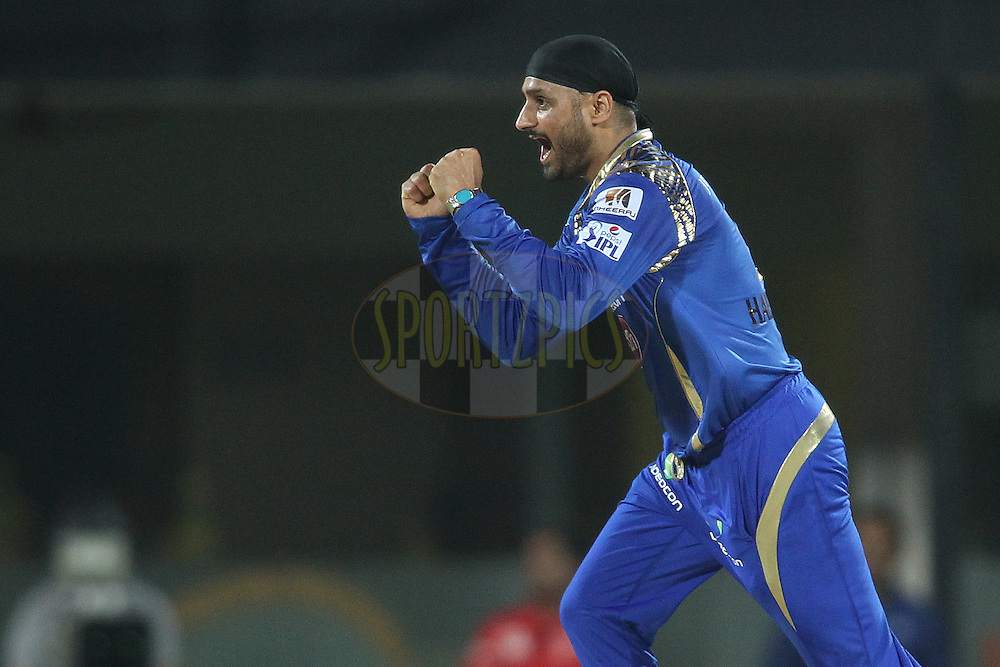 Harbhajan Singh of Mumbai Indians celebrates getting Dwayne Smith of Chennai Super Kings wicket during match 43 of the Pepsi IPL 2015 (Indian Premier League) between The Chennai Super Kings and The Mumbai Indians held at the M. A. Chidambaram Stadium, Chennai Stadium in Chennai, India on the 8th May April 2015.<br /> <br /> Photo by:  Shaun Roy / SPORTZPICS / IPL