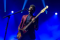 &copy; Licensed to London News Pictures. 28/03/2014. London, UK.   Metronomy performing live at Brixton Academy to promote their latest album Love Letters.  In this picture - Olugbenga Adelekan.  Metronomy are an english electronic music group consisting of members Joseph Mount (vocals, Guitar, keyboard),<br /> Oscar Cash (keyboards/sax), Anna Prior (bass), Olugbenga Adelekan (drums).   Photo credit : Richard Isaac/LNP
