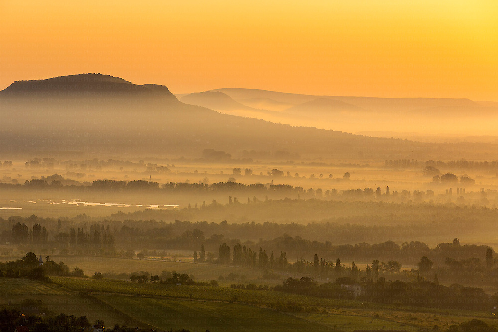 Landscape image of Szent Gyorgy-hegy at sunrise with mist in valley, Balaton, Veszprem, Hungary, July, 2014.