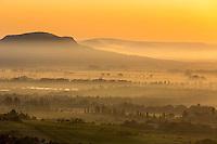 Landscape image of Szent Gyorgy-hegy at sunrise with mist in valley, Balaton, Veszprem, Hungary, July, 2014.