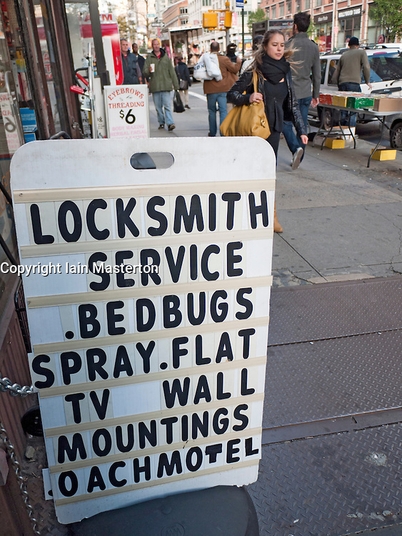 Sign outside hardware store in New York City offering bedbug cleaning services