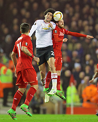 LIVERPOOL, ENGLAND - Thursday, March 10, 2016: Liverpool's Joe Allen and Manchester United's Marouane Fellaini during the UEFA Europa League Round of 16 1st Leg match at Anfield. (Pic by David Rawcliffe/Propaganda)