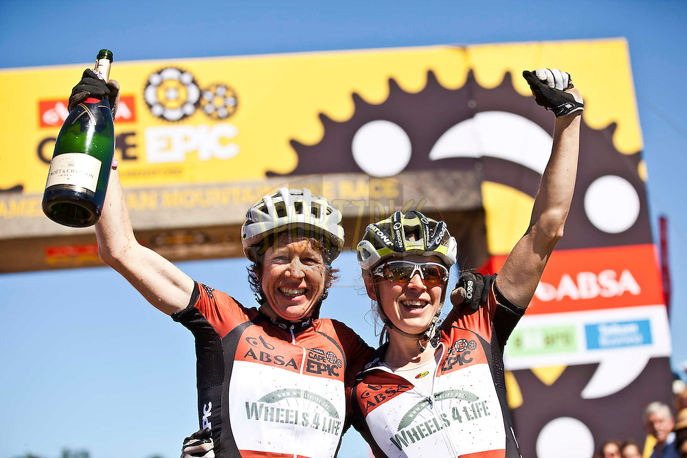 Ester Suss and Sally Bingham of Wheels4life celebrate their overall ladies win during the final stage (stage 7) of the 2012 Absa Cape Epic Mountain Bike stage race held from Oak Valley Wine Estate in the Elgin Valley to Lourensford Wine Estate, South Africa on the 1 April  2012..Photo by Nick Muzik/Cape Epic/SPORTZPICS