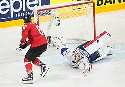Cristobal Huet of France vs Vincent Praplan of Switzerland during penalty shots during the 2017 IIHF Men's World Championship group B Ice hockey match between National Teams of Switzerland and France, on May 9, 2017 in Accorhotels Arena in Paris, France. Photo by Vid Ponikvar / Sportida