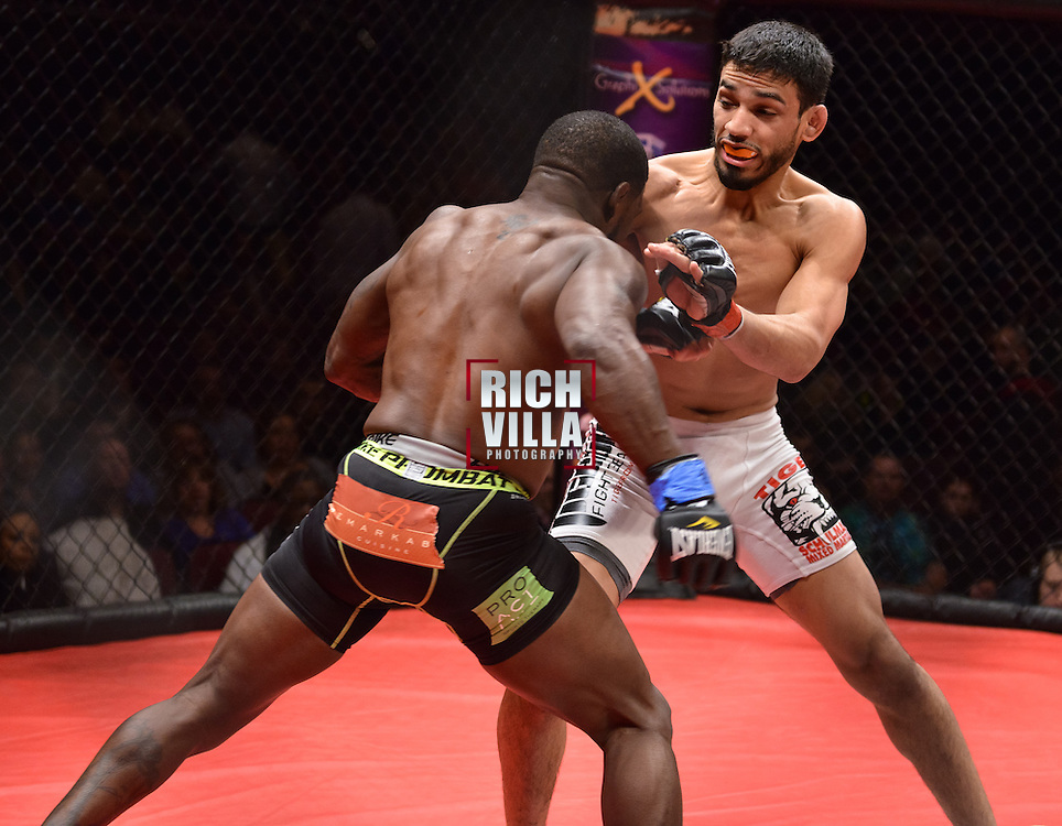 Atlantic City, New Jersey, January 24, 2014: Julio Arce(white shorts) Vs Jason Mclean(black shorts) at Ring of Combat 47 at The Tropicana Casino