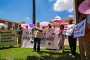 """31 JULY 2012 - PHOENIX, AZ: DENNIS STOUT, center, from the organization Veterans for Peace, talks about the use of drone, or unmanned aerial vehicles, in domestic US airspace, at the Arizona State Capitol Tuesday. Stout was there to support Medea Benjamin, a political activist, best known for co-founding Code Pink and, along with her husband, activist and author Kevin Danaher, the fair trade advocacy group Global Exchange. Benjamin appeared in Phoenix to promote her new book, """"Drone Warfare: Killing by Remote Control."""" She, and other members of Code Pink, presented a letter to Arizona Gov. Jan Brewer protesting Brewer's request to use the state's airspace to train drone pilots.   PHOTO BY JACK KURTZ"""