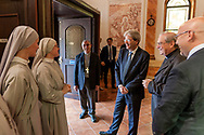 ROME, ITALY - SEPTEMBER 01: Italian PM Paolo Gentiloni  with the voluntary sisters during visit the Citadel of the Charity of the Diocesan Caritas of Rome on September 1, 2017 in Rome, Italy. Italian PM Paolo Gentiloni visit the Caritas is to express the gratitude of all Italians to the world of volunteering, to those who work in favour of solidarity.