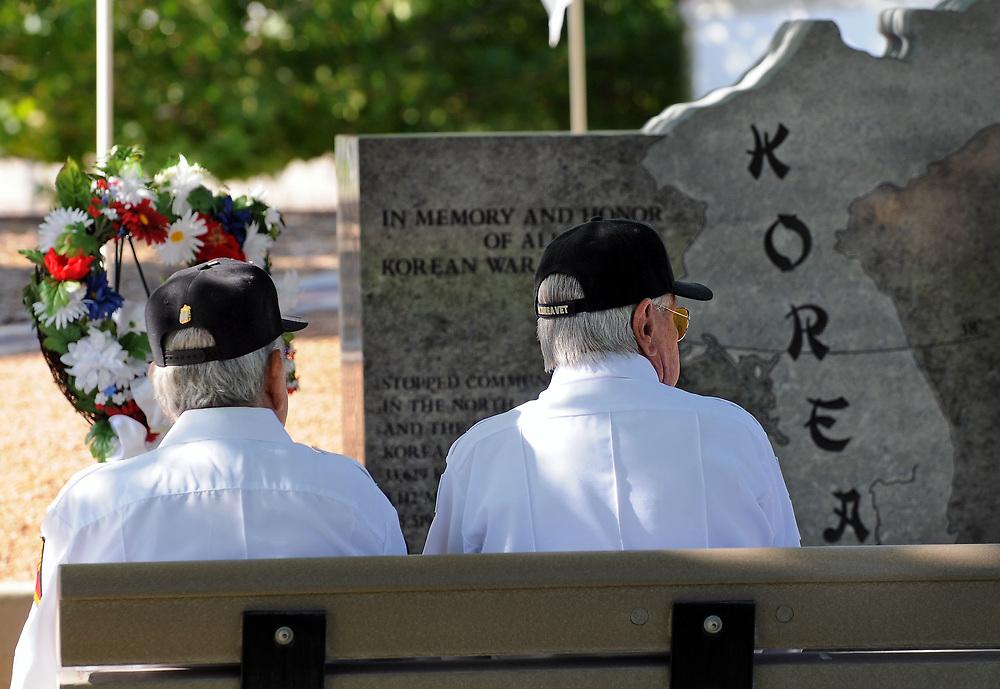 jt052917b/ a sec/jim thompson/ left to right - Korean War Veterans Joe Medina and Stan Jarocki sit on a bench across from the Korean War monument at the New Mexico Veteran's Memorial. Monday May. 29, 2017. (Jim Thompson/Albuquerque Journal)