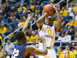 Nov 20, 2016; Morgantown, WV, USA; West Virginia Mountaineers guard Teyvon Myers (0) shoots a three pointer during the second half against the New Hampshire Wildcats at WVU Coliseum. Mandatory Credit: Ben Queen-USA TODAY Sports