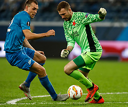 October 4, 2018 - Saint Petersburg, Russia - Artem Dzyuba (L) of FC Zenit Saint Petersburg and Ondrej Kolar of SK Slavia Prague vie for the ball during the Group C match of the UEFA Europa League between FC Zenit Saint Petersburg and SK Sparta Prague at Saint Petersburg Stadium on October 4, 2018 in Saint Petersburg, Russia. (Credit Image: © Mike Kireev/NurPhoto/ZUMA Press)