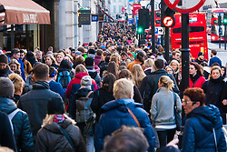 "London, December 20th 2014. Tens of thousands of shoppers descend on central London to scoop up pre-Christmas bargains as retailers offer discount incentives on ""Panic Saturday"". PICTURED: Crowds of Christmas shoppers pack London's Regents Street."