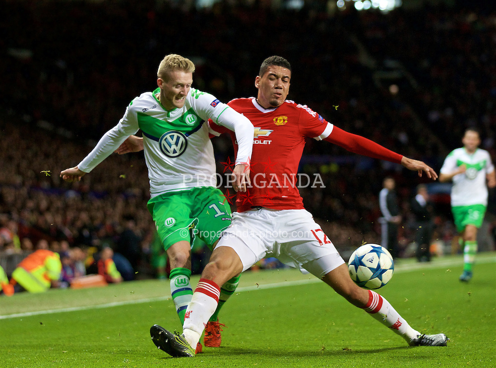 MANCHESTER, ENGLAND - Wednesday, September 30, 2015: Manchester United's Chris Smalling in action against VfL Wolfsburg's André Schürrle during the UEFA Champions League Group B match at Old Trafford. (Pic by David Rawcliffe/Propaganda)