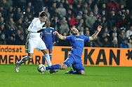 Swansea city's Michu fouls Chelsea's Branislav Ivanovic. Capital one cup semi final, 2nd leg, Swansea city v Chelsea at the Liberty Stadium in Swansea on Wednesday 23rd Jan 2013. pic by Andrew Orchard, Andrew Orchard sports photography,