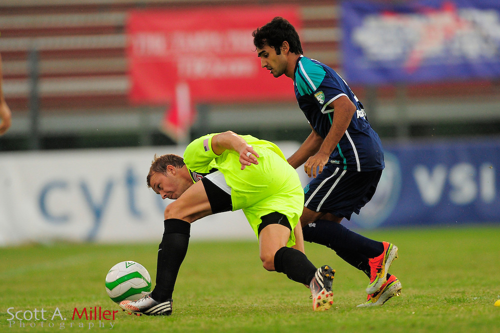 VSI Tampa Bay FC defender Alex Freitas (8) in action against the Phoenix FC Wolves in a USL Pro soccer match at Plant City stadium in Plant City, Florida on June 9, 2013.<br /> <br /> &copy;2013 Scott A. Miller