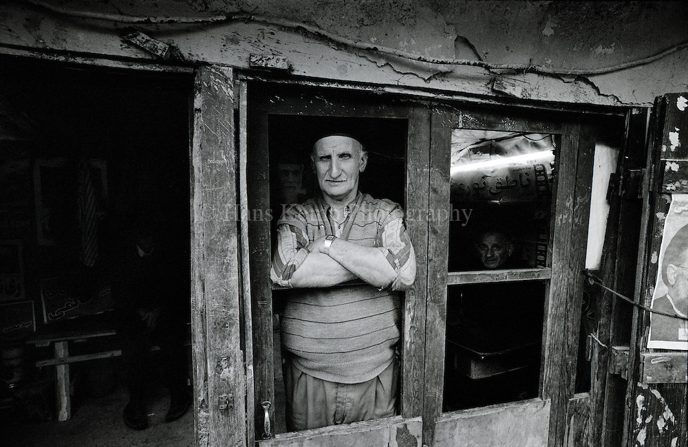 A man stares out of the window in the village of Masuleh, a remote mountain village in Northern Iran, 1007