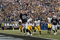 OAKLAND, CA - DECEMBER 09: Tight end Lee Smith #86 of the Oakland Raiders catches a pass for a touchdown against the Pittsburgh Steelers during the fourth quarter at the Oakland Coliseum on December 9, 2018 in Oakland, California. The Oakland Raiders defeated the Pittsburgh Steelers 24-21. (Photo by Jason O. Watson/Getty Images) *** Local Caption *** Lee Smith