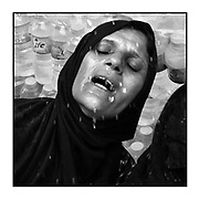 Faces of Mosul<br /> <br /> A collection of images from 4 time Pulitzer prize winning photographer Carol Guzy, gives us a glimpse into the faces of those affected by the fierce conflict with ISIS in Mosul. Wounded and weak, most who survived now face an uncertain future in the limbo of IDP camps. Shattered lives, lost loved ones and escape from the rubble of collapsed homes and the evil of ISIS doctrine, leaves scars of emotional trauma even more difficult to heal. The war in Mosul is over, but the humanitarian crisis continues.<br /> <br /> Mosul, Iraq - A refugee has water splashed on her face by volunteers at a Trauma Stabilization Point. Civilians, many injured and weak, flee in brutal heat as the fierce battle with ISIS continues in West Mosul amid ruins of the Old City. <br />  &copy;Carol Guzy/zReportage.com/Exclusivepix Media