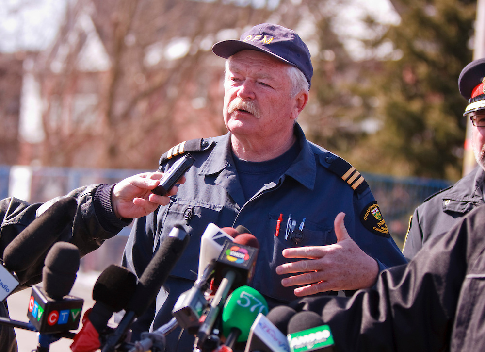 Bill Hiscott from the Ontario Fire Marshal's office speaks to the media following the discovery of remains of one of 2 missing residents in the rubble of an apartment building in Woodstock Ontario, Wednesday, March 30, 2011. The building exploded Sunday morning.<br /> THE CANADIAN PRESS/ Geoff Robins