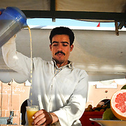 One of the many orange juice sellers trading in Djemma el-Fna in Marrakech.