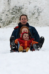 © Licensed to London News Pictures.  05/02/2011.ELY, UK. Liz Morris (back right), Will Morris, 5, (middle right) and Ben Manning, 4 (front right) narrowly avoid crashing  while sledging in Cherry Hill Park, Ely after a heavy (15cm+) overnight snowfall. *** Verbal permission obtained from parents of the named children ***. Photo credit :  Cliff Hide/LNP