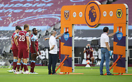 Michail Antonio of West Ham United glances over as Wolves sleep them waiting during the Premier League match at the London Stadium, London. Picture date: 20th June 2020. Picture credit should read: David Klein/Sportimage