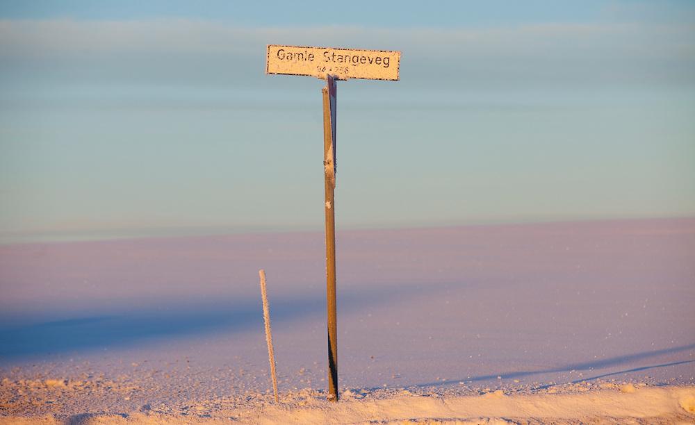 Norway Winter freezing cold snow january sun sunny Stange Norwegian winter.Street sign field fields Norwegian winterscape