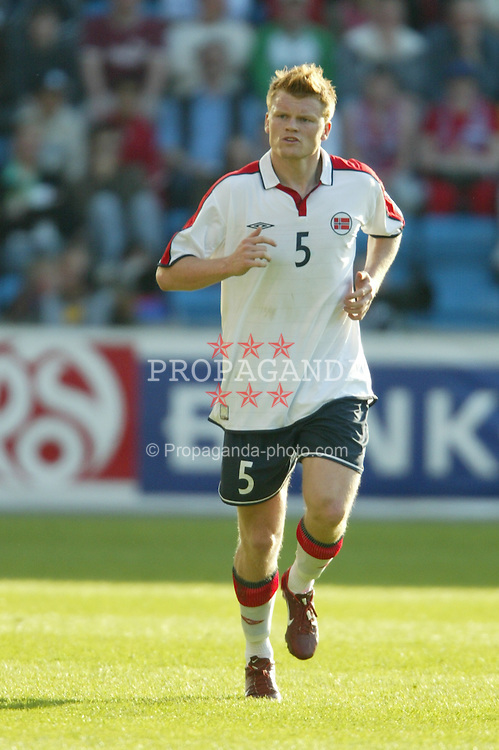 OSLO, NORWAY - Thursday, May 27, 2004:  Norway's John Arne Riise in action against Wales during the International Friendly match at the Ullevaal Stadium, Oslo, Norway. (Photo by David Rawcliffe/Propaganda)