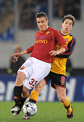 Matteo Brighi and Samir Nasri  compete for the ball during the UEFA Champions League, Round of Last 16, Second Leg match between AS Roma and Arsenal at the Stadio Olimpico on March 11, 2009 in Rome, Italy.