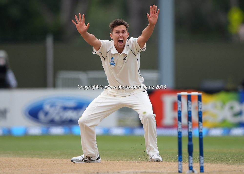 Trent Boult appeals unsuccessfully for a LBW decision on Day 4 of the 1st cricket test match of the ANZ Test Series. New Zealand Black Caps v West Indies at University Oval in Dunedin. Friday 6 December 2013. Photo: Andrew Cornaga/www.Photosport.co.nz