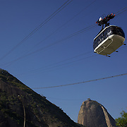 Cable cars taking tourists and sightseers to and from the top of Sugar Loaf Mountain, one of the iconic tourist destinations in Rio de Janeiro. Rio de Janeiro, Brazil. 24th August 2010. Photo Tim Clayton.