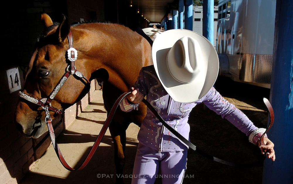 """pvcAPALOOSA1/9-18-07/ASEC.  Fourteen year old Caitlyn Chappelle (CQ) of Albuquerque, holds the reins of her ten year old horse named """"Bullet"""" as Chappelle gets ready to compete in the New Mexico State Fair Apaloosa horse show, photographed Tuesday Sept. 18, 2007.  (Pat Vasquez-Cunningham/Journal)"""