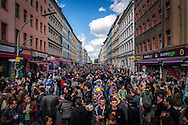"01/05/2015 – Berlin, Germany: Overcrowded Adalbertstraße in during the ""Myfest"" street festival. ""Myfest"" takes place in district SO 36, the traditional centre of riots that usually occur during May Day celebrations and it was organized to decreased the violence caused by Revolutionary May Day Demonstrations.  The radical left wing criticises such events claiming that it is pretended to pacify social conflicts and to ban radical demonstrations. The International Workers Day is a celebration of laborers and the working classes that is promoted by the international labor movement, anarchists, socialists, and communists and occurs every year on May Day. (Eduardo Leal)"