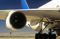 Man inspecting engine of passenger jet