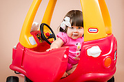 Toddler playing with Little Tikes Cozy Coupe