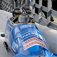 01 March 2009:     The Germany 2 bobsled driven by Andre Lange with sidepushers Alexander Roediger and Kevin Kuske, and brakeman Martin Putze glance at the clock as they finish their 2nd place run at the 4-Man World Championships competition on March 1 at the Olympic Sports Complex in Lake Placid, NY.   The USA 1 bobsled driven by Steven Holcomb with sidepushers Justin Olsen and Steve Mesler, and brakeman Curtis Tomasevicz won the competition and the World Championship bringing the U.S. their first world championship since 1959 with a time of 3:36.61.