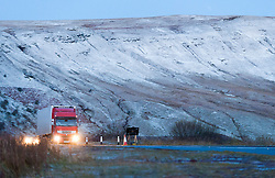 © Licensed to London News Pictures. 18/11/2016. Brecon Beacons National Park, Powys, Wales, UK. Traffic negotiates the A470 road at Storey Arms in the Brecon Beacons. Freezing temperatures and a bitterly cold wind this morning after a light snow fall last night in the Brecon Beacons in Powys, Wales, UK. Photo credit: Graham M. Lawrence/LNP