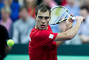 Jerzy Janowicz of Poland competes in the first single match during first day of the BNP Paribas Davis Cup 2013 between Poland and South Africa at MOSiR Hall in Zielona Gora on April 05, 2013...Poland, Zielona Gora, April 05, 2013..Picture also available in RAW (NEF) or TIFF format on special request...For editorial use only. Any commercial or promotional use requires permission...Photo by © Adam Nurkiewicz / Mediasport