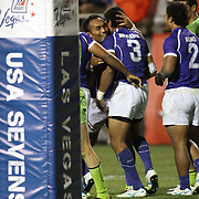 Manu Samoa's Uale Mai hugs teamate Faatoina Autagavaia after his try in the second half vs. Australia.  Photo by Barry Markowitz, 2/10/12