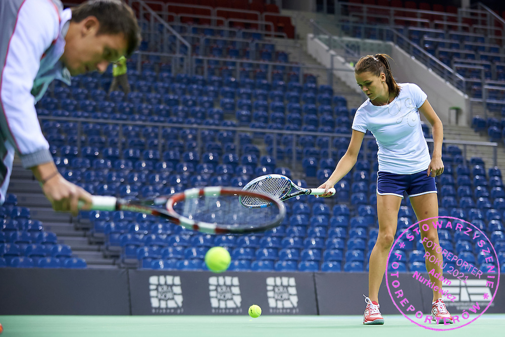 (R) Agnieszka Radwanska and (L) trainer assistant Dawid Celt both from Poland during official training session two days before the Fed Cup / World Group 1st round tennis match between Poland and Russia at Krakow Arena on February 5, 2015 in Cracow, Poland.<br />