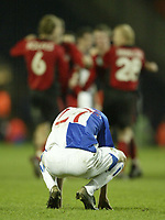 Photo: Aidan Ellis.<br /> Blackburn Rovers v Bayer Leverkusen. UEFA Cup, 2nd Leg. 22/02/2007.<br /> Rovers Matt Devonshire is down and out at the final whistle as Bayer players celebrate going nthrough to the next round