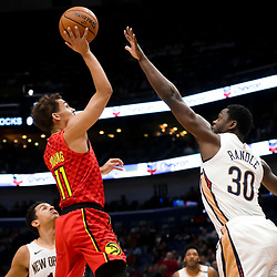 Mar 26, 2019; New Orleans, LA, USA; Atlanta Hawks guard Trae Young (11) shoots over New Orleans Pelicans center Julius Randle (30) during the first quarter at the Smoothie King Center. Mandatory Credit: Derick E. Hingle-USA TODAY Sports