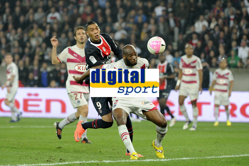 FOOTBALL - FRENCH CHAMPIONSHIP 2011/2012 - L1 - PARIS SAINT GERMAIN v GIRONDINS BORDEAUX - 25/03/2012 - PHOTO JEAN MARIE HERVIO / REGAMEDIA / DPPI - MICHAEL CIANI (GDB) / GUILLAUME HOARAU (PSG)