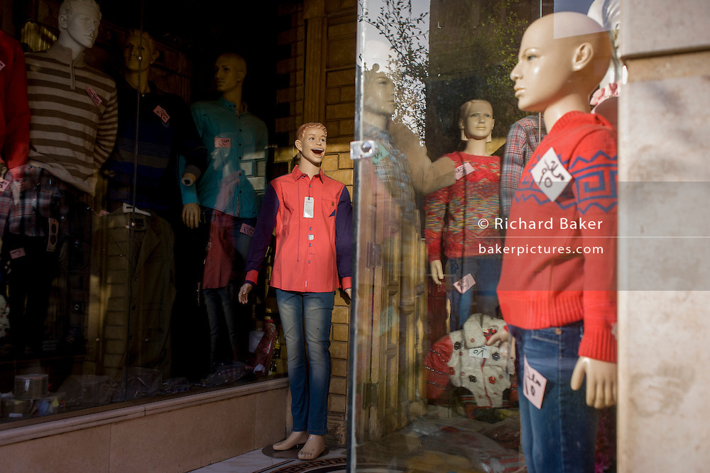 Mannequins in the window of a clothing business displaying western-style clothes in modern Luxor, Nile Valley, Egypt.