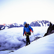 Todd ascending the Boston Basin towards the West Ridge of Forbidden Peak