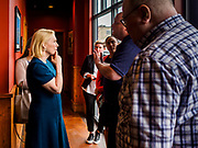 17 APRIL 2019 - DES MOINES, IOWA: US Senator KIRSTEN GILLIBRAND (D-NY), left, talks a Des Moines businessperson before a meet and greet with Drake University students at a restaurant in Des Moines. Gillibrand is touring Iowa this week to support her candidacy to be the Democratic nominee for the US Presidency. Iowa traditionally hosts the the first selection event of the presidential election cycle. The Iowa Caucuses will be on Feb. 3, 2020.              PHOTO BY JACK KURTZ