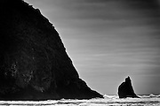 "Haystack Rock and one of ""The Needles"" - sea stacks on the Oregon Coast at Cannon Beach."
