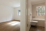 interior of new apartment, empty room with bathroom, parquet floor